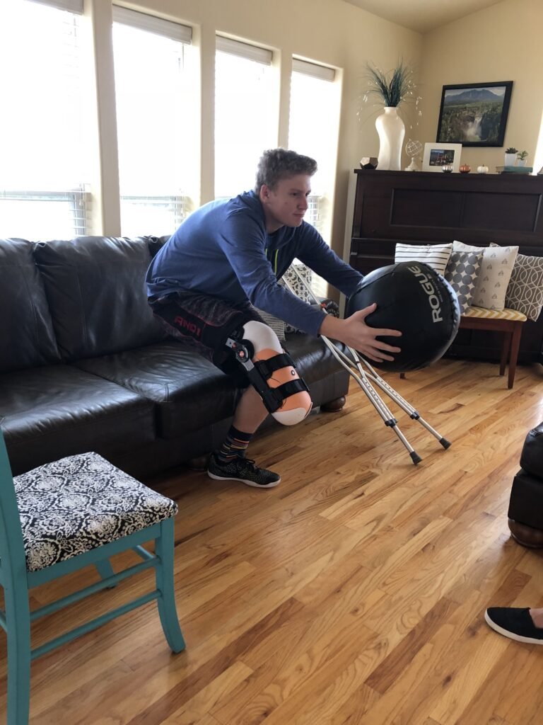 Drew Haley works out to strengthen his core muscles following a 2018 football injury that resulted in the loss of part of his right leg.