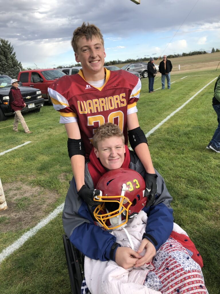 Brayden Haley assists his brother, Drew, following Drew's 2018 football injury that resulted in the loss of part of his right leg.