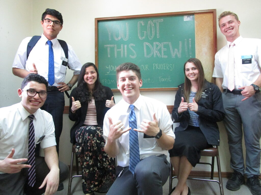 Elder Morley Haley, center, and fellow missionaries from the Argentina Santa Fe Mission share encouragement for Haley's younger brother, Drew Haley.