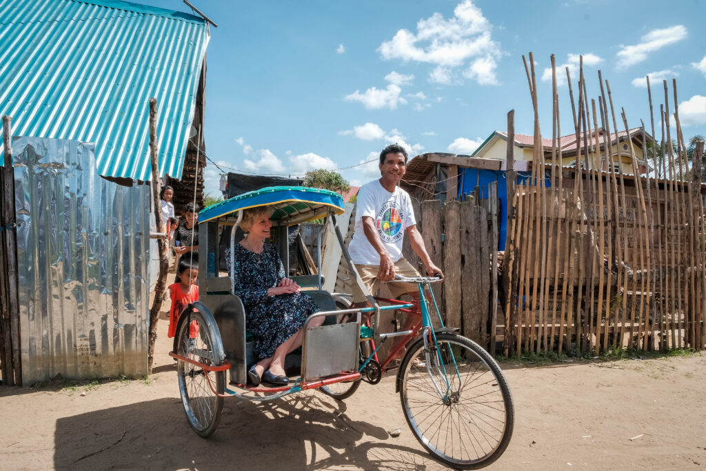 Rodrigo Sarmiento gives Sister Jean B. Bingham a ride on his pedicab in Catarman, Philippines, on Feb. 3, 2020. Sister Bingham visited the area to learn of a new stake pilot program focused on malnutrition.