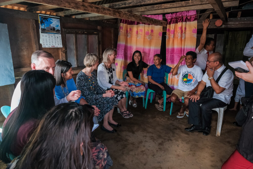 Sister Jean B. Bingham, center, visits the Sarmiento family at their home in Catarman, Philippines, on Feb. 3, 2020. Sister Bingham visited the area to learn of a new stake pilot program focused on malnutrition.