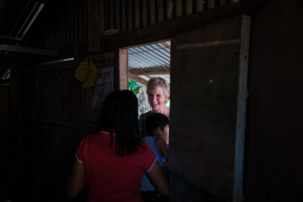 Sister Jean B. Bingham, center, visits the Donor family at their home in Catarman, Philippines, on Feb. 3, 2020. Sister Bingham visited the area to learn of a new stake pilot program focused on malnutrition.