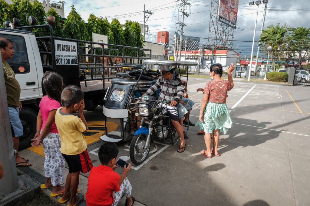 Evacuees from the Lemery branch sit in a tricycle motorbike in the parking lot of the Batangas Philippines Stake Center on Feb. 6, 2020.