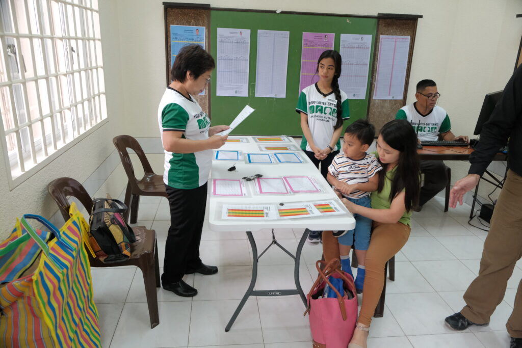 Members of the Toledo Philippines District review data collected from a child malnutrition screening hosted by the district on Feb. 8, 2020.