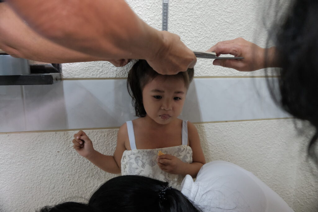 A child in the Toledo Philippines District gets measured during a screening for malnutrition hosted by the district on Feb. 8, 2020.