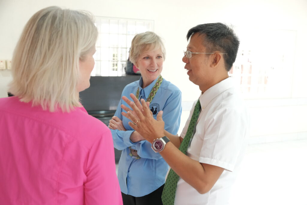 Sister Jean B. Bingham, center, chats with the Toledo Philippines District President Lauro Bautista Jr., right, during a malnutrition screening hosted by the district on Saturday, Feb. 8, 2020.