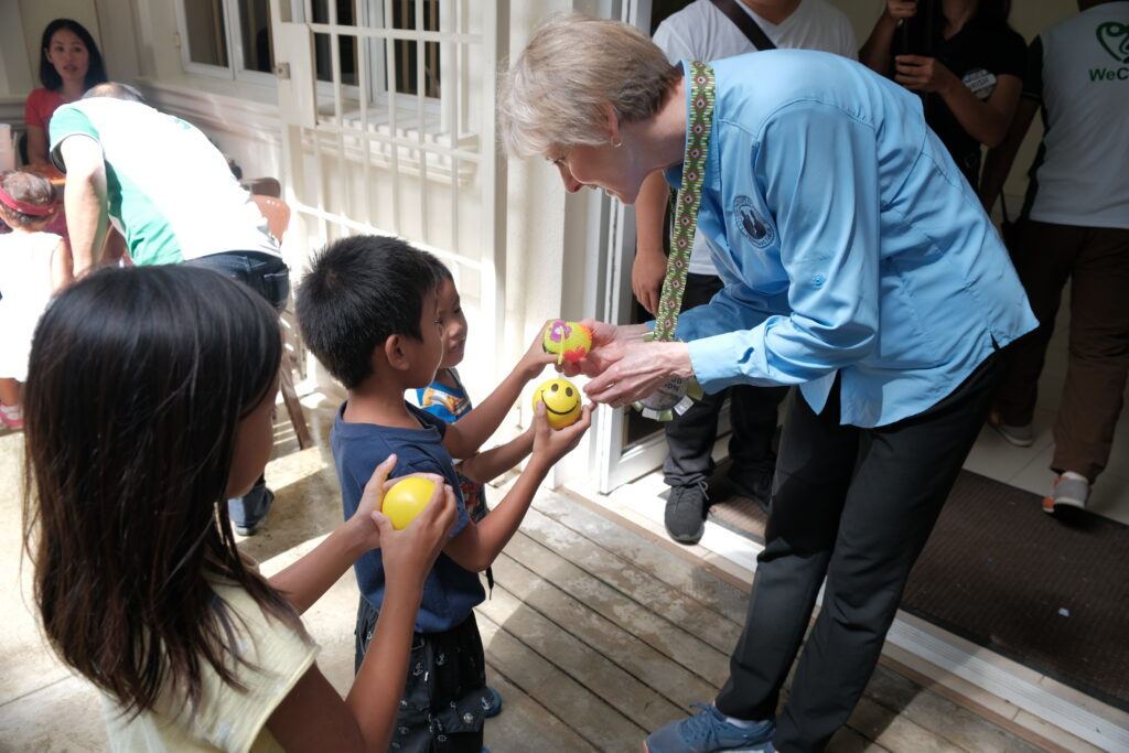 Sister Jean B. Bingham greets some of the children in the Toledo Philippines District during a malnutrition screening hosted by the district on Saturday, Feb. 8, 2020.