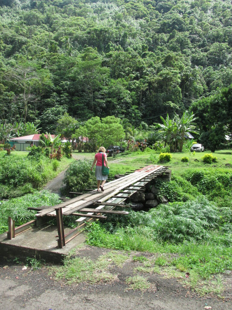 Sister Morgan Taylor crosses a bridge while proselytizing during her mission to Tahiti.