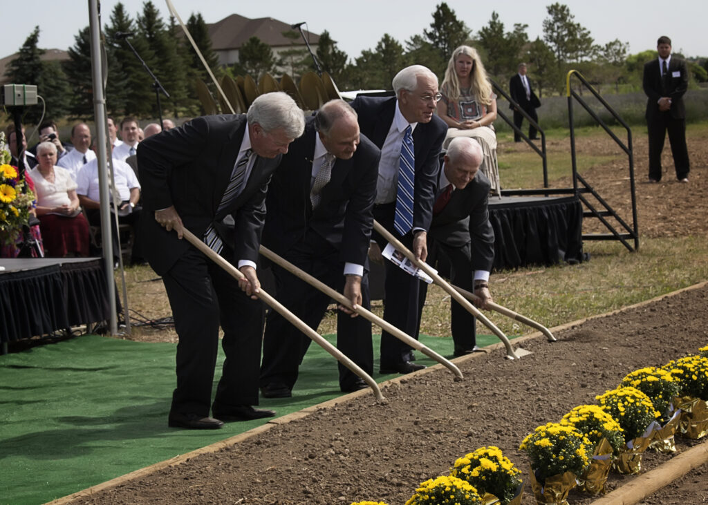 Breaking ground at the site of the new Fort Collins Colorado Temple are (left to right) Denver Temple President Robert K. Bills and Elder Ronald A. Rasband, Elder William R. Walker and Elder George F. Rhodes, Jr. of the Seventy on Aug. 25, 2013.