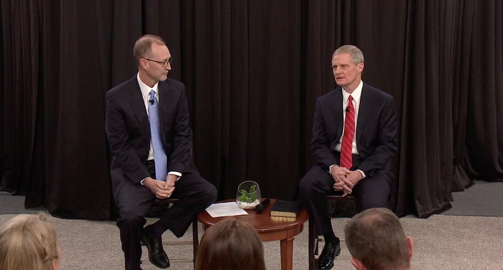 "Elder David A. Bednar, right, speaks during the Church Educational System's annual ""Evening with a General Authority"" on Feb. 7, 2020. Chad Webb, administrator of Seminaries and Institutes of Religion is seated at his left."