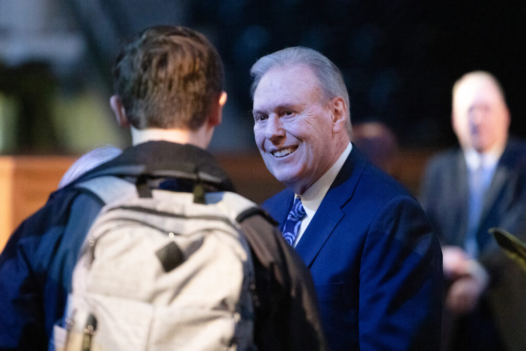 Elder Terence M. Vinson of the Presidency of the Seventy speaks with students prior to speaking at a Brigham Young University campus devotional in the Marriott Center in Provo, Utah, on Feb. 11, 2020.
