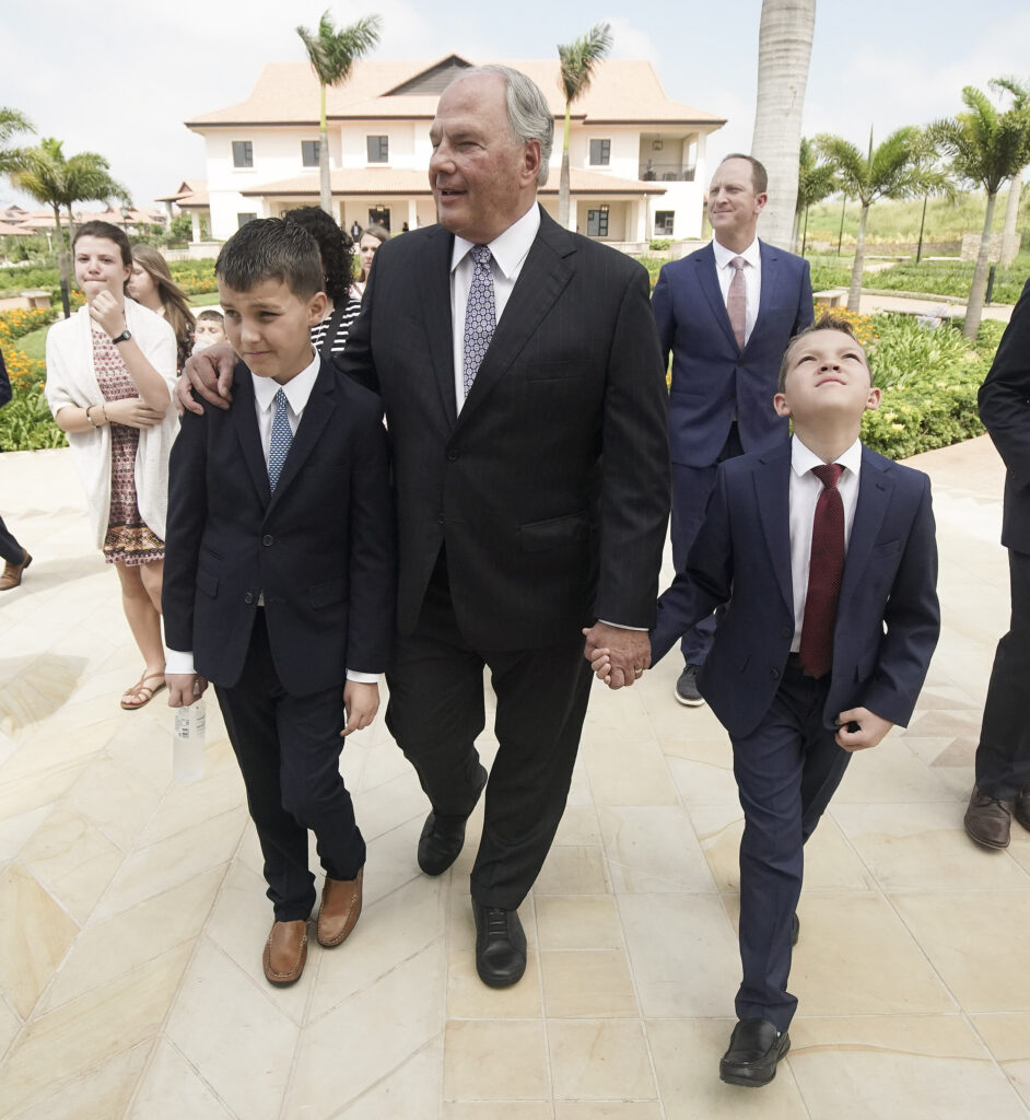 Elder Ronald A. Rasband, of The Church of Jesus Christ of Latter-day Saints' Quorum of the Twelve Apostles, walks with his grandsons Ronald William Rasband and Mackay Norton as they give a tour of the Durban South Africa Temple in Umhlanga, South Africa, on Saturday, Feb. 15, 2020.