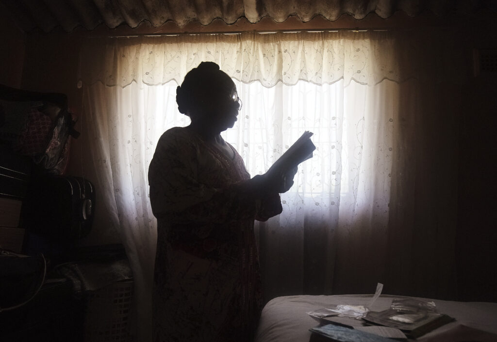 Nokuthula Gladys Gumede reads her Book of Mormon at her home in Umlazi, South Africa, on Feb. 14, 2020.