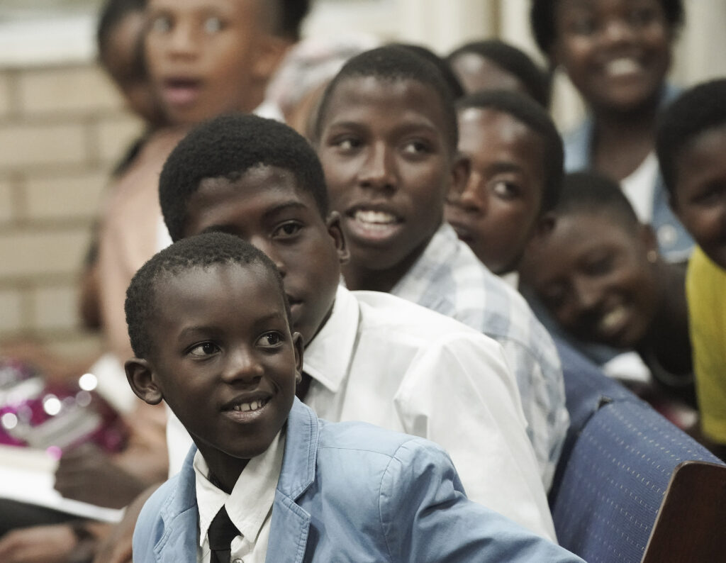 Sinqobile Mkhize and other youth listen as Elder Ronald A. Rasband, of The Church of Jesus Christ of Latter-day Saints' Quorum of the Twelve Apostles, speaks during a Durban South Africa Temple youth devotional in Durban, South Africa, on Saturday, Feb. 15, 2020.