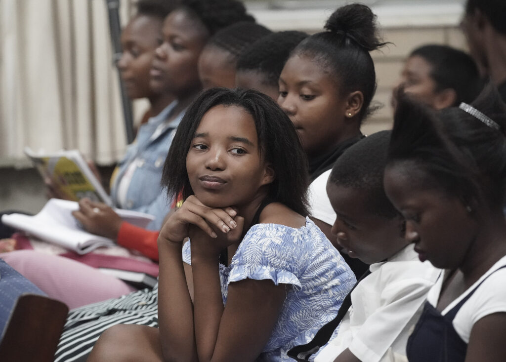 Amahle Luthuli and other youth attend as Elder Ronald A. Rasband, of The Church of Jesus Christ of Latter-day Saints' Quorum of the Twelve Apostles, speaks during a Durban South Africa Temple youth devotional in Durban, South Africa, on Saturday, Feb. 15, 2020.