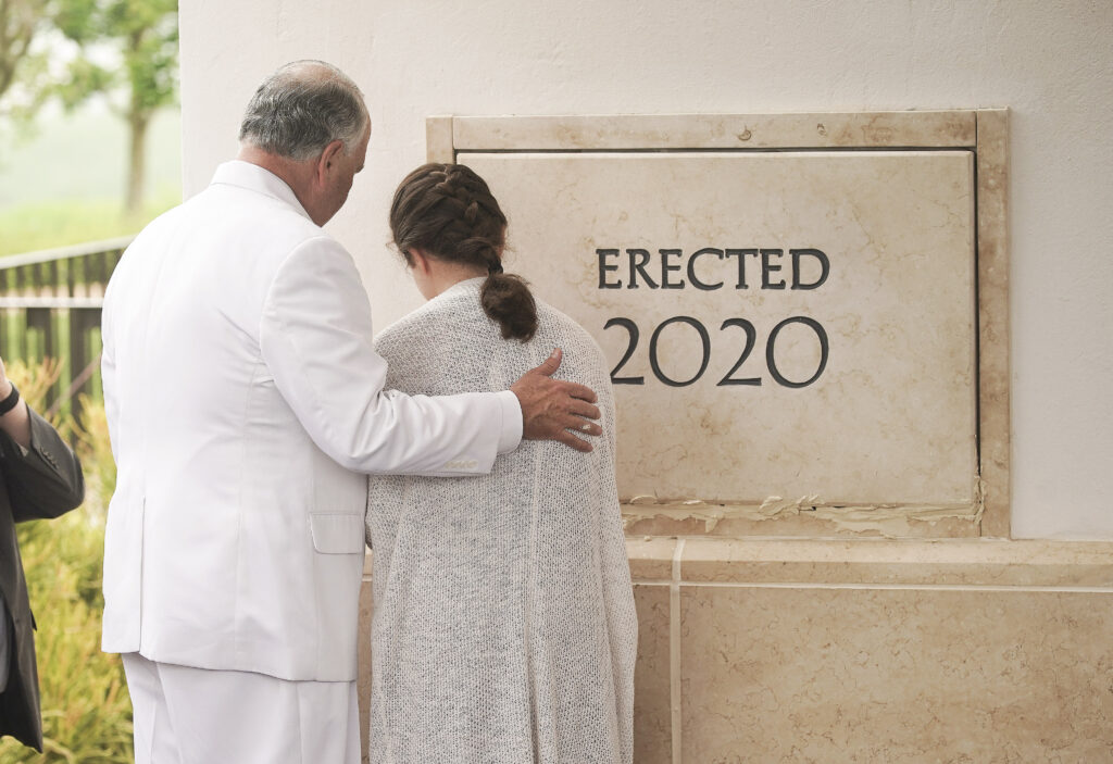 Elder Ronald A. Rasband, of The Church of Jesus Christ of Latter-day Saints' Quorum of the Twelve Apostles, helps his granddaughter Ella Chase with mortar during the cornerstone ceremony for the Durban South Africa Temple dedication in Umhlanga, South Africa, on Sunday, Feb. 16, 2020.
