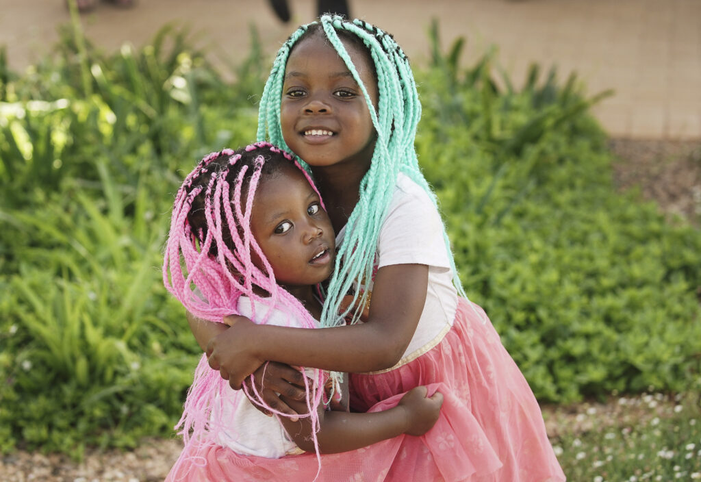 Tadiwa Chitiyo and her sister Tatenda hug during outside the Durban South Africa Temple on the day of its dedication in Umhlanga, South Africa, on Sunday, Feb. 16, 2020.