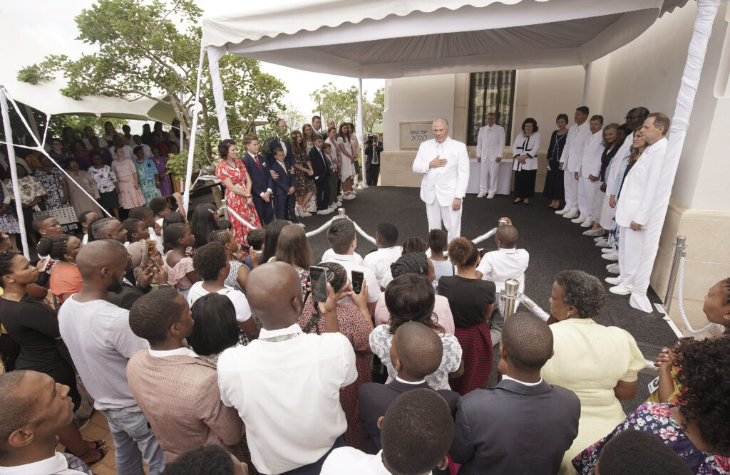 Elder Ronald A. Rasband, of The Church of Jesus Christ of Latter-day Saints' Quorum of the Twelve Apostles, talks with attendees during the cornerstone ceremony for the Durban South Africa Temple dedication in Umhlanga, South Africa, on Sunday, Feb. 16, 2020.