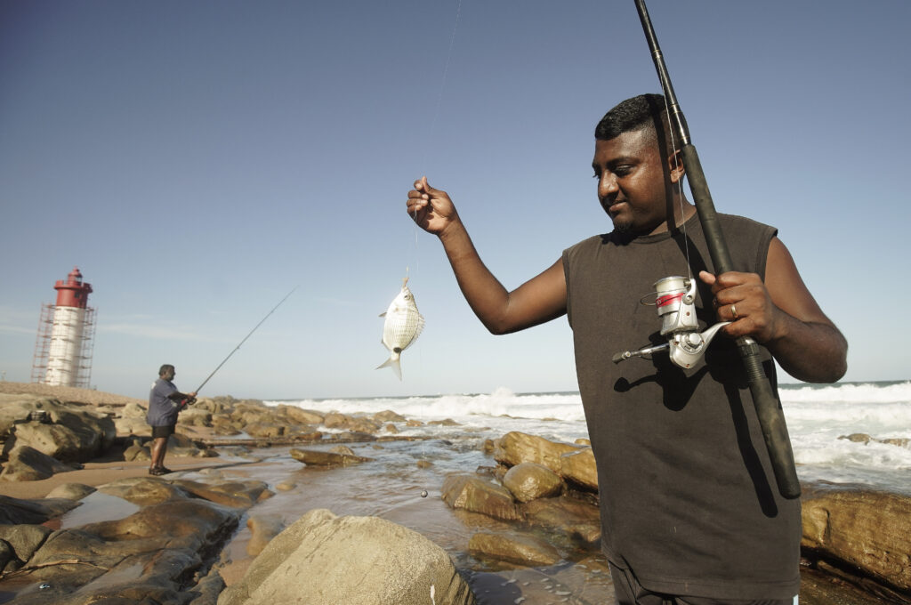A fisherman catches a flatfish in Inidna Ocean near Umhlanga, South Africa, on Feb. 13, 2020.