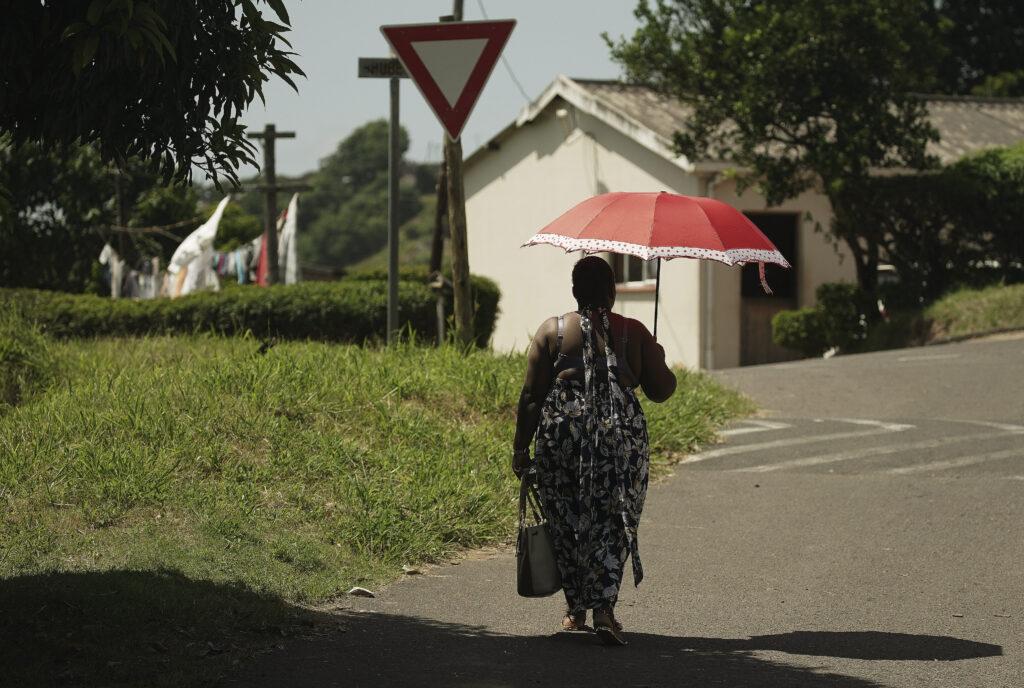 A woman walks thorough a neighborhood in Umlazi, South Africa, on Feb. 14, 2020.