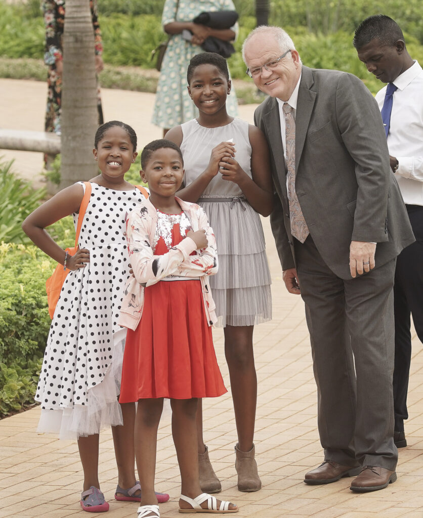 Church News managing editor Scott Taylor poses with Vuyo Tyukwana, Monica Makhatini and Iya Makhatini outside the Durban South Africa Temple prior to its dedication in Umhlanga, South Africa, on Sunday, Feb. 16, 2020.