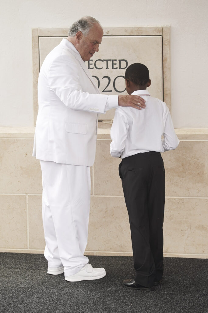 Elder Ronald A. Rasband, of The Church of Jesus Christ of Latter-day Saints' Quorum of the Twelve Apostles, assists Siseko Phungunla with mortar during the cornerstone ceremony for the Durban South Africa Temple dedication in Umhlanga, South Africa, on Sunday, Feb. 16, 2020.