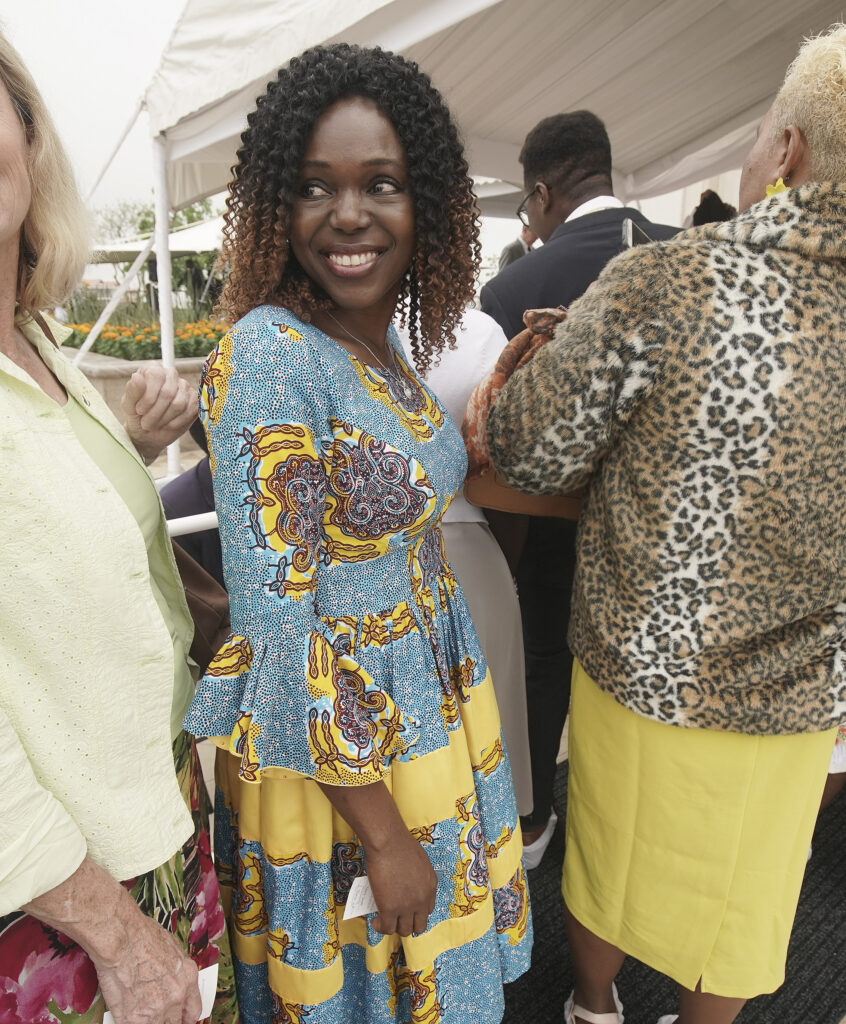 Laura Udobong smiles while waiting in line for the Durban South Africa Temple dedication in Umhlanga, South Africa, on Sunday, Feb. 16, 2020.