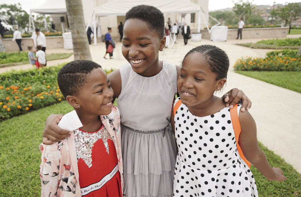 Iya Makhatini, Vuyo Tyukwana, and Monica Makhatini smile outside the Durban South Africa Temple on its dedication day in Umhlanga, South Africa, on Sunday, Feb. 16, 2020.