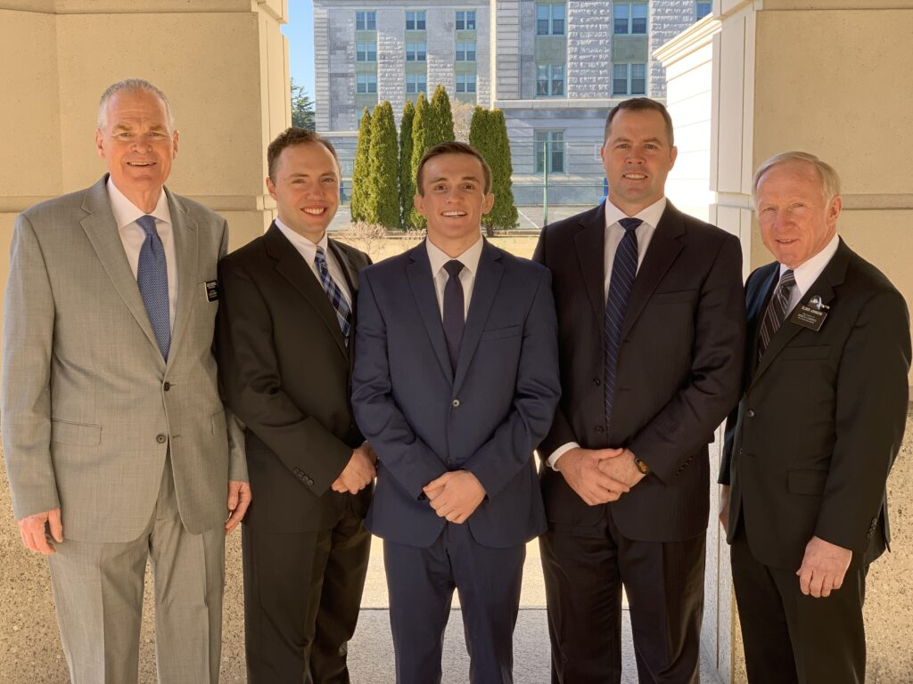 Navy wrestler Casey Cobb, center, serves as the second counselor in the recently-formed Naval Academy Branch. Cobb's joined by fellow members of presidency, from left, Elder Lyn Loyd Creswell, first counselor; Christopher Vincent, branch executive secretary; Casey Cobb; Branch President Joe DuPaix; Elder Dennis Johnson, branch clerk.