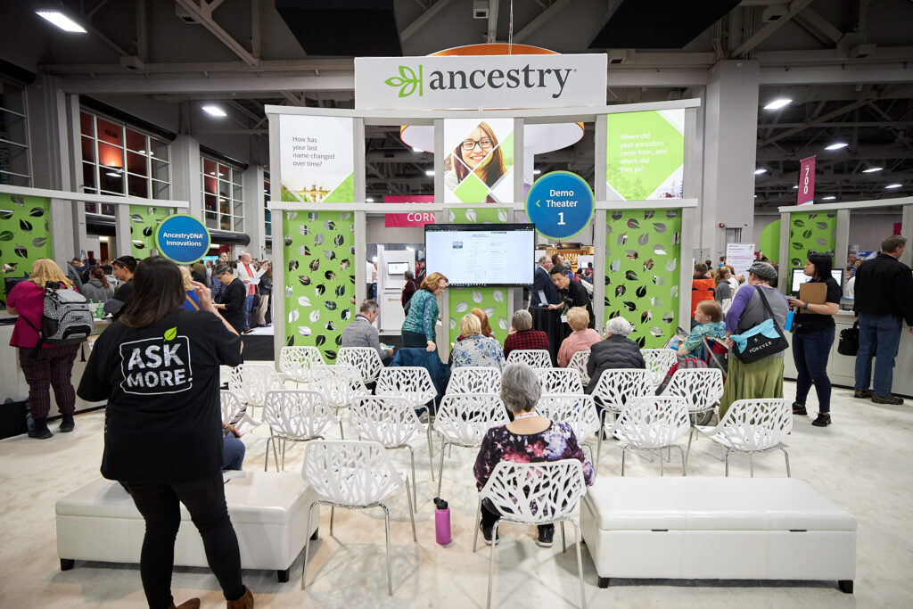 RootsTech attendees take their seats for a demonstration at the Ancestry booth in the expo hall in the Salt Palace on Wednesday, Feb. 27.