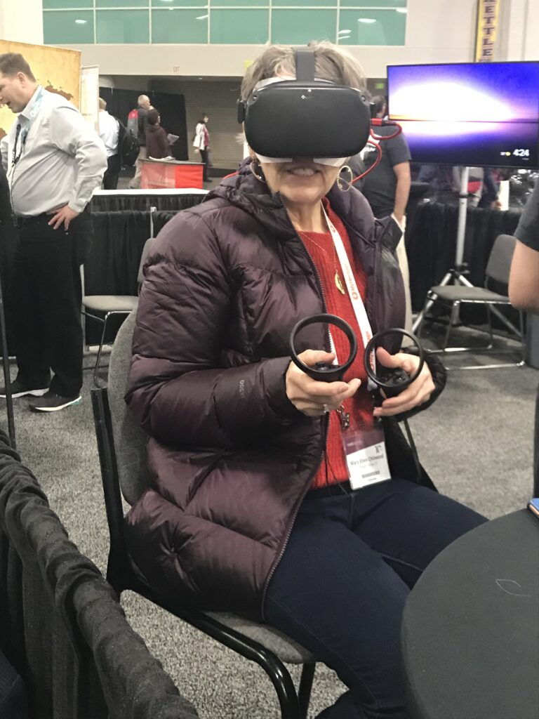 A RootsTech attendee tries out the virtual reality homeland experience in the expo hall on Thursday, Feb. 27.