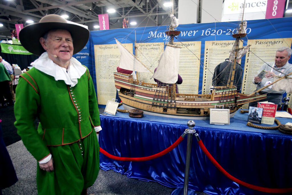 George Garmany, governor general of the Mayflower Society, stands next to a replica of the Mayflower after joining Steve Rockwood of FamilySearch and Brenton Simons of American Ancestors onstage talking about their collaboration to digitize records of Mayflower descendants at the Salt Palace Convention Center in Salt Lake City on Friday, Feb. 28, 2020.