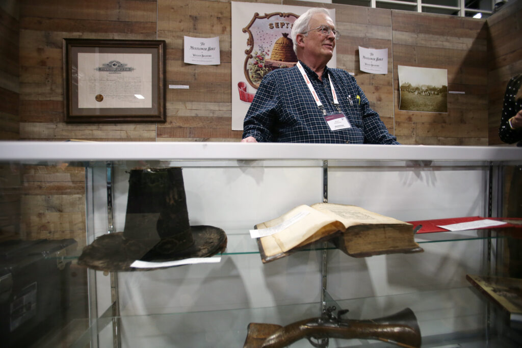 Collector Brent Ashworth talks with visitors about the John Calvin New Testament Bible in Old Dutch that sailed on the Mayflower and is on display during RootsTech at the Salt Palace Convention Center in Salt Lake City on Friday, Feb. 28, 2020.