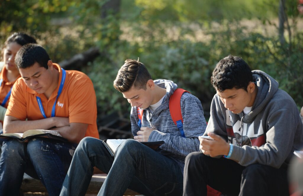 Young men study the scriptures at an FSY conference in 2015.