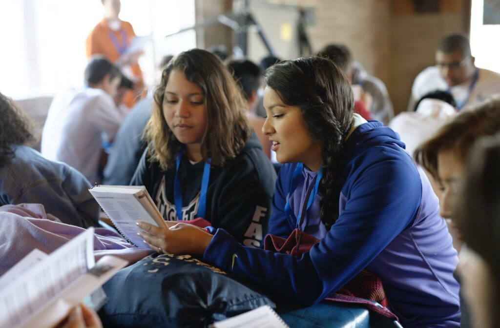 Young women study the gospel during a For the Strength of Youth Conference in 2015.