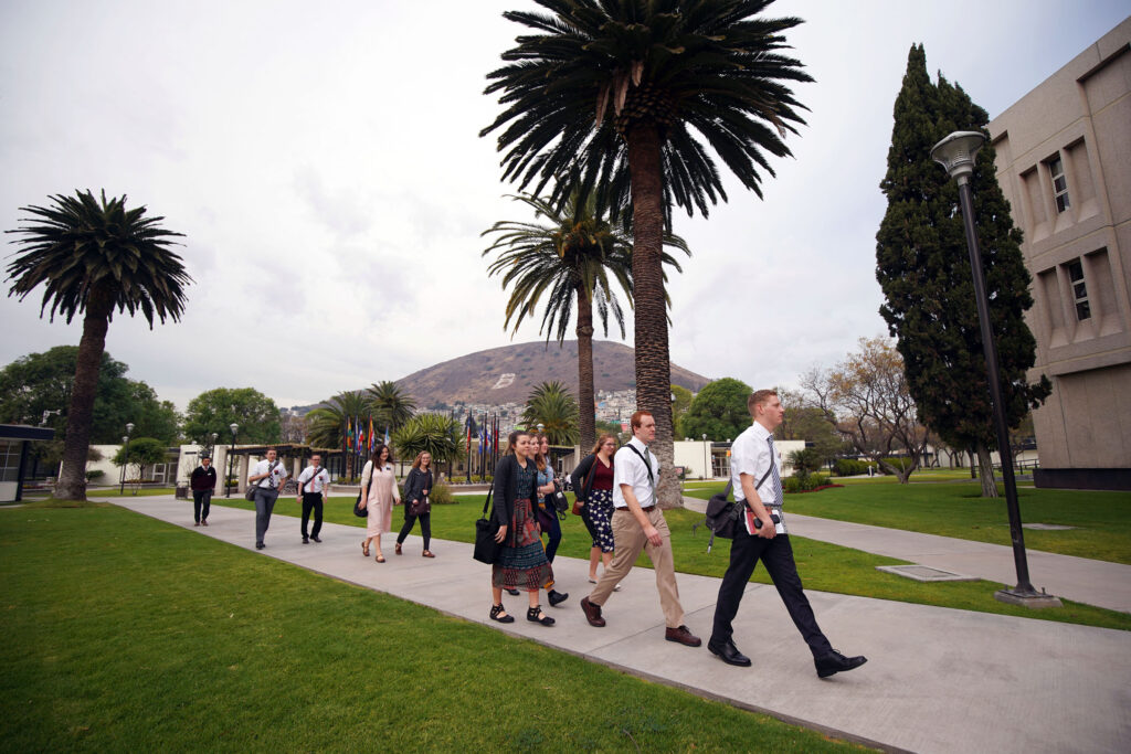 Missionaries walk between buildings at the Mexico Missionary Training Center of The Church of Jesus Christ of Latter-day Saints on Friday, Jan. 24, 2020.