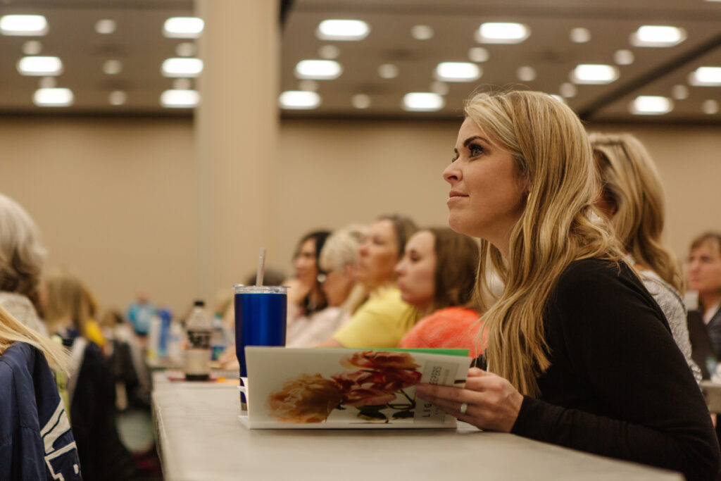 An attendee listens duringLight Keepers, a RootsTech event for Latter-day Saint women at the Salt Palace Convention Center in Salt Lake City on Feb. 28, 2020.