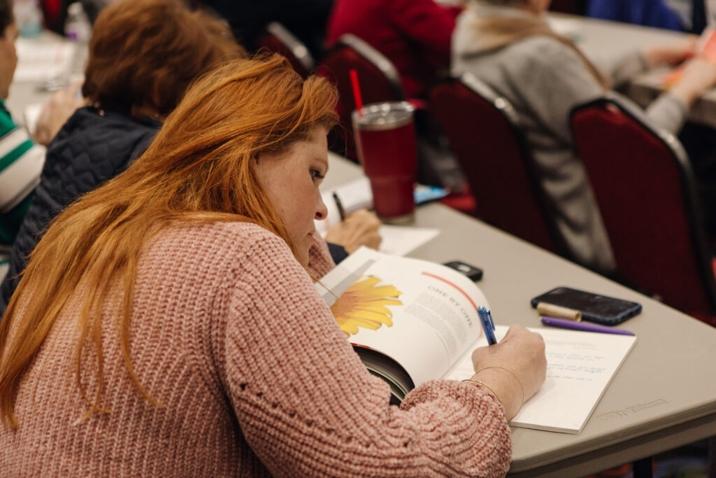 An attendee takes notes duringLight Keepers, a RootsTech event for Latter-day Saint women at the Salt Palace Convention Center in Salt Lake City on Feb. 28, 2020.