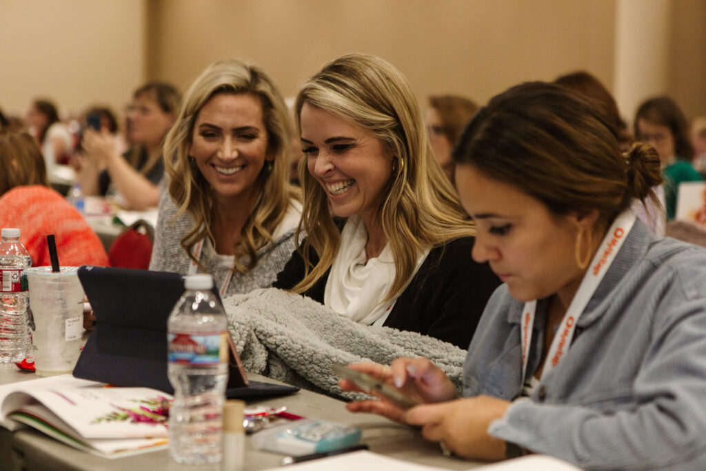 Attendees smile during Light Keepers, a RootsTech event for Latter-day Saint women at the Salt Palace Convention Center in Salt Lake City on Feb. 28, 2020.