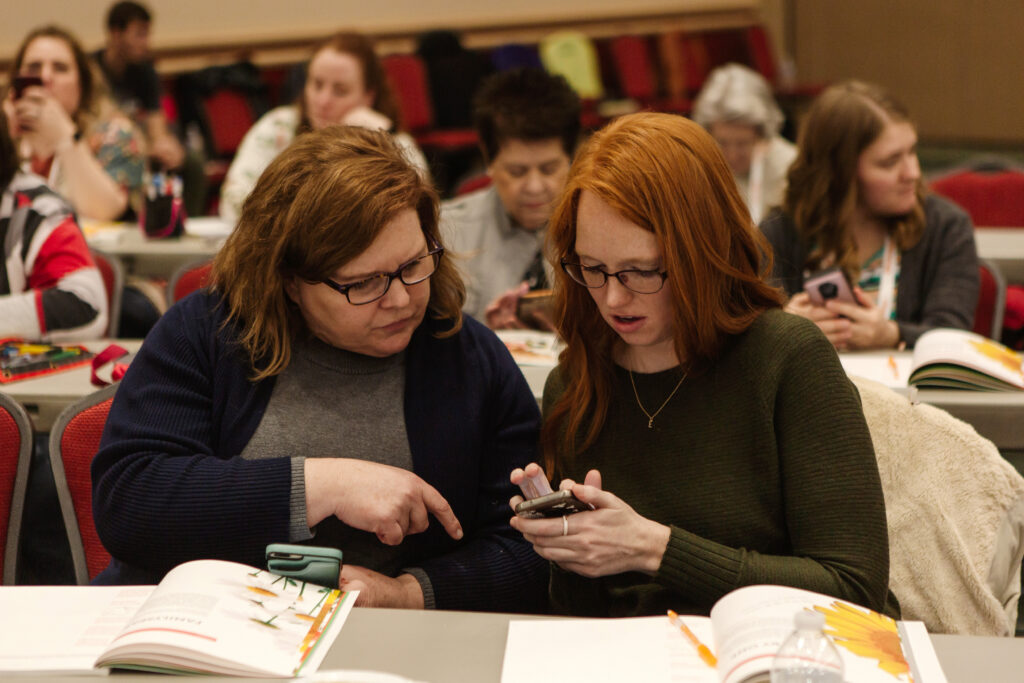 Attendees use the Family Tree app during Light Keepers, a RootsTech event for Latter-day Saint women at the Salt Palace Convention Center in Salt Lake City on Feb. 28, 2020.