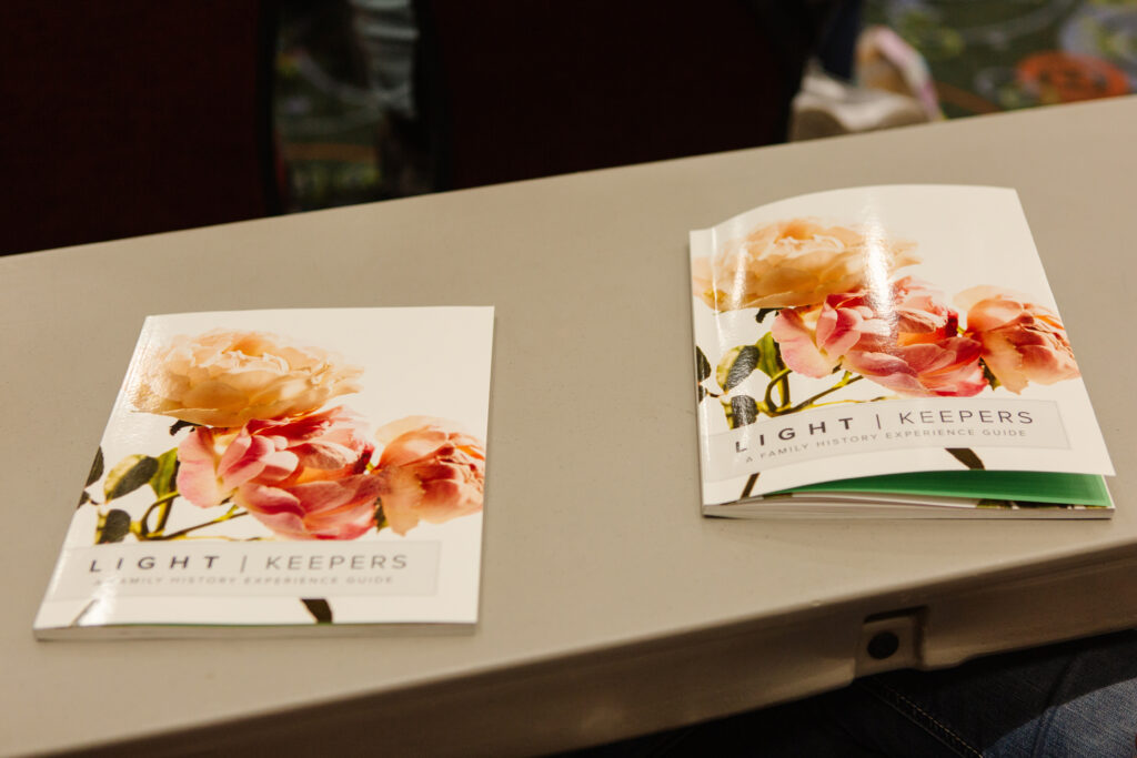 Two workbooks lie on a table during Light Keepers, a RootsTech event for Latter-day Saint women at the Salt Palace Convention Center in Salt Lake City on Feb. 28, 2020.