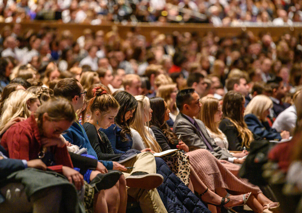 Students in the BYU-Idaho Center on March 1, 2020, listen to counsel from Elder Dieter F. Uchtdorf and Sister Harriet Uchtdorf.