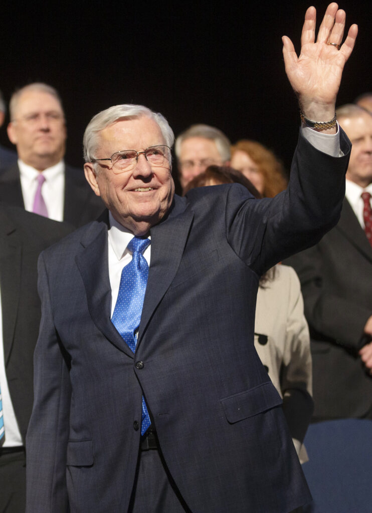 President M. Russell Ballard, acting president of the Quorum of the Twelve Apostles of The Church of Jesus Christ of Latter–day Saints waves to the crowd as he exits the stand after speaking at a BYU devotional in the Marriott Center in Provo on Tuesday, March 3, 2020.