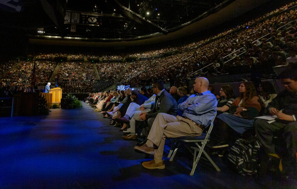 Crowd members listen as President M. Russell Ballard, acting president of the Quorum of the Twelve Apostles of The Church of Jesus Christ of Latter–day Saints speaks at a BYU devotional in the Marriott Center in Provo on Tuesday, March 3, 2020.