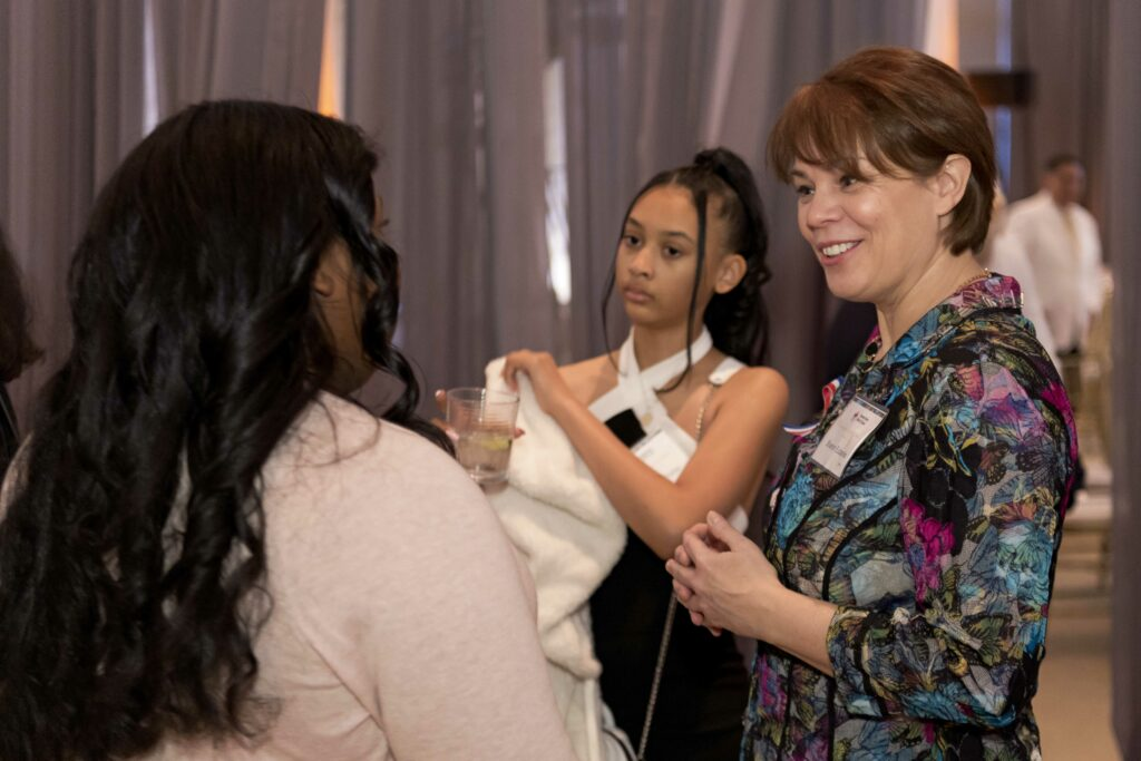 Sister Sharon Eubank, right, mingles with attendees at the annual leadership awards dinner at the American Red Cross Headquarters in Washington D.C. on March 4, 2020.