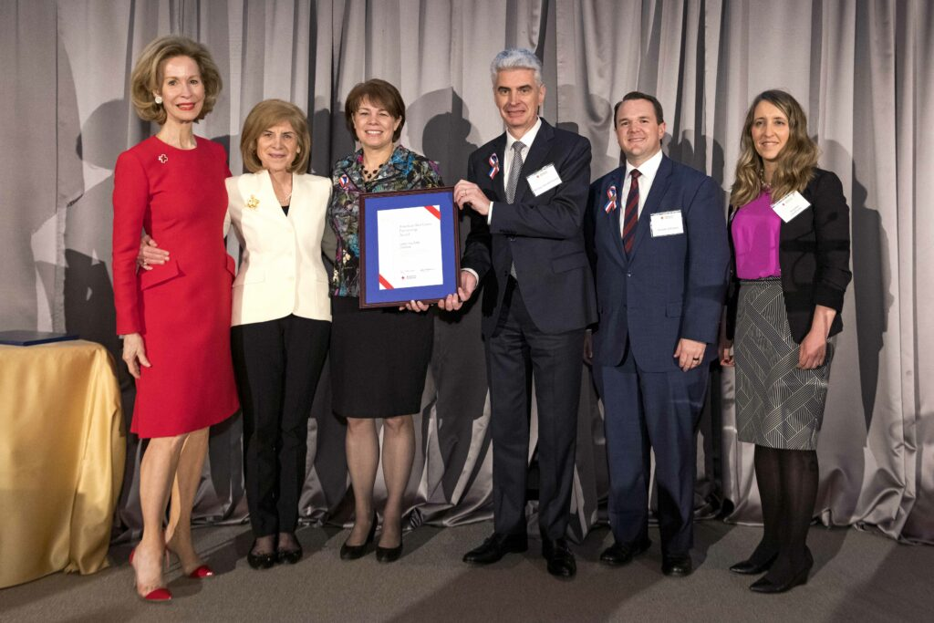 Presiding Bishop Gérald Caussé, center, and Sister Sharon Eubank, center left, receive on behalf of Latter-day Saint Charities the American Red Cross Partnership Award at the organization's annual leadership awards dinner in Washington D.C. on March 4, 2020.