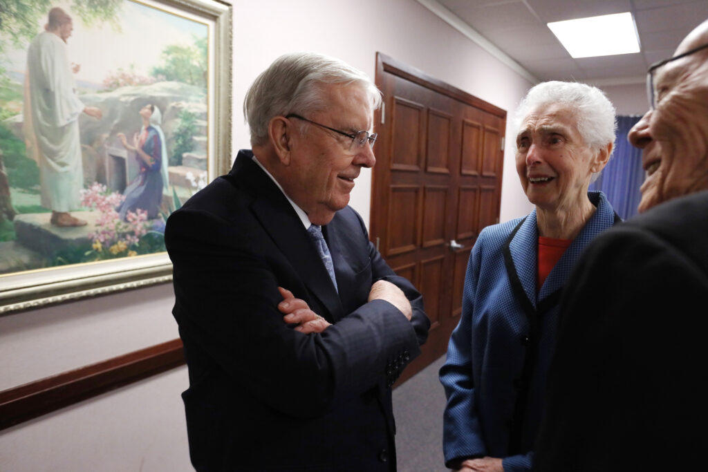 President M. Russell Ballard, acting president of the Quorum of the Twelve Apostles, greets friends June and Everett Pallin at the Brampton Stake Center in Brampton, Ontario, Canada, March 6, 2020.