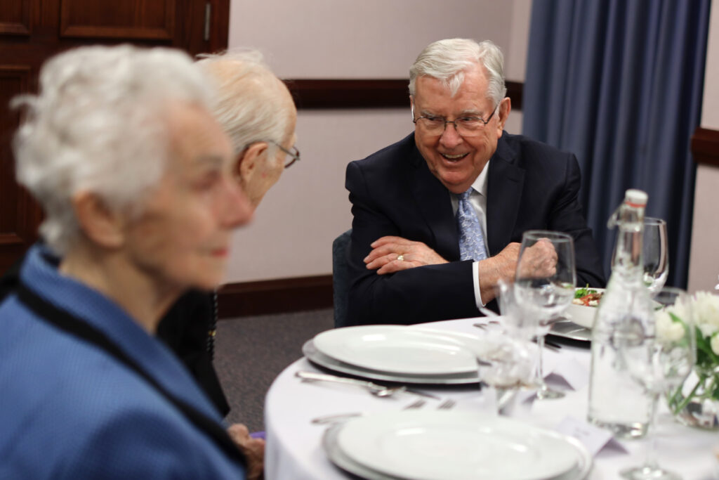 President M. Russell Ballard, acting president of the Quorum of the Twelve Apostles, has dinner with old friends at the Brampton Stake Center in Brampton, Ontario, Canada, March 6, 2020.