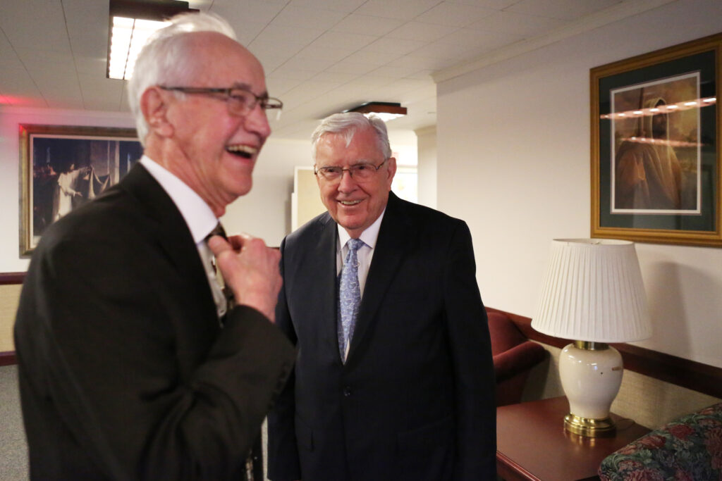 President M. Russell Ballard, acting president of the Quorum of the Twelve Apostles, shares laugh with Bruce Smith upon meeting at the Brampton Stake Center in Brampton, Ontario, Canada, March 6, 2020.