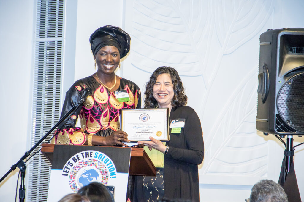 Sister Reyna Isabel Aburto, right, stands withMame T. Mbaye, the Honorary Consul General for Senegal, at the fourth annual International Women-in-Diplomacy Day, which was held at the Los Angeles California Temple Visitors' Center on Monday, March 9, 2020.